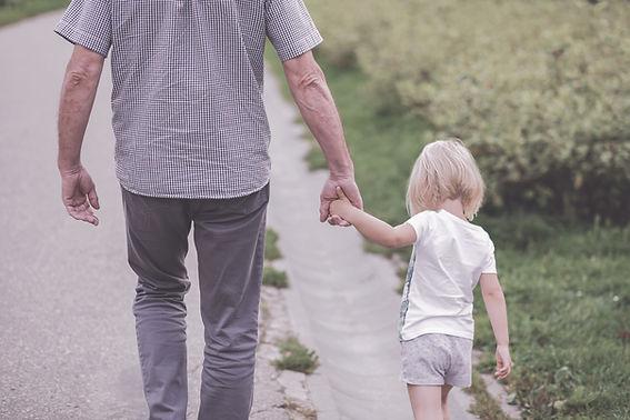 Canva - Man and Child Walking Near Bushe