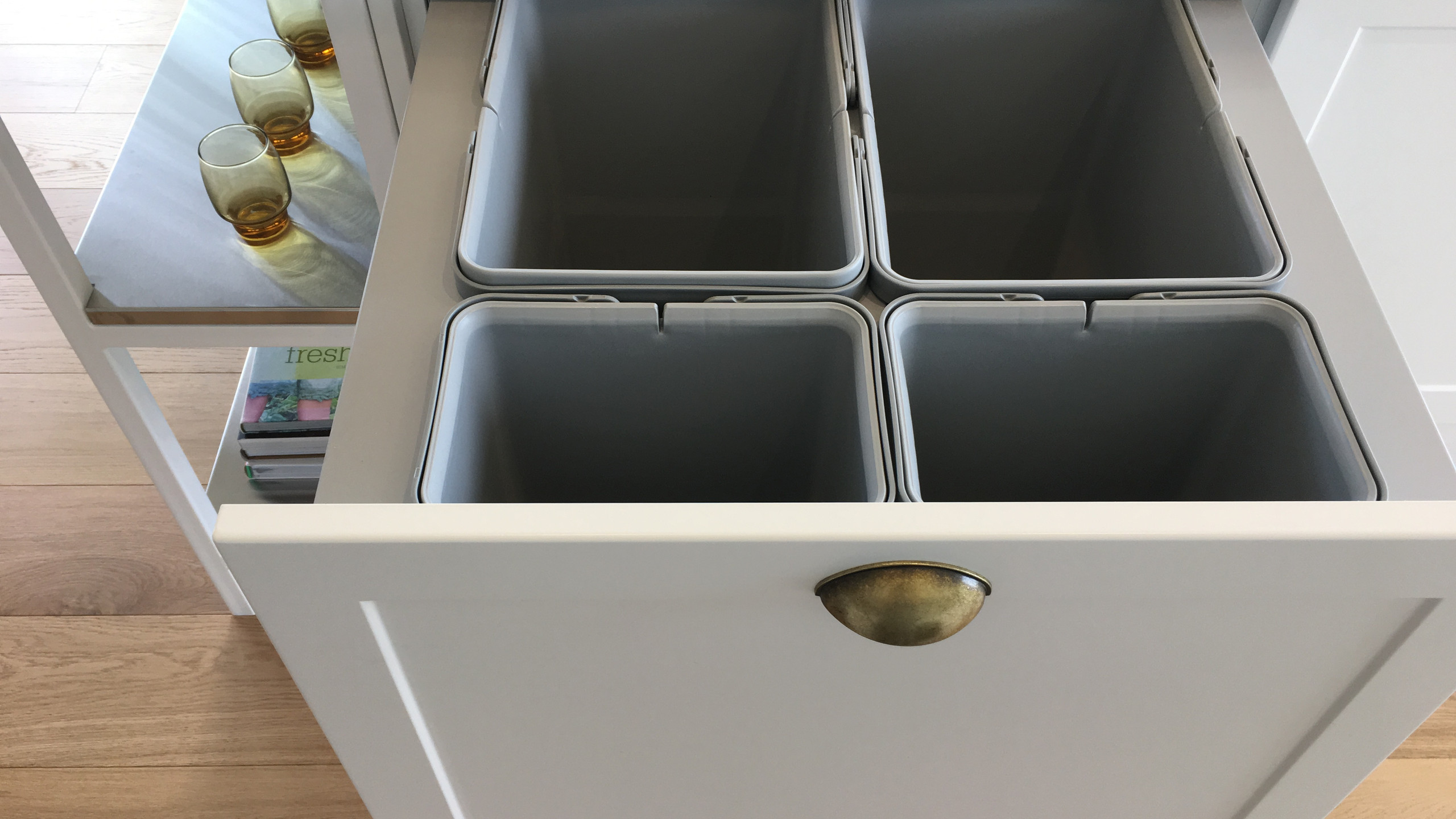 Larger rubbish bin with different compartments for recycling.