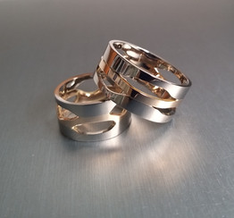 Unique, 100% handmade wedding rings. White and yellow 14K gold.