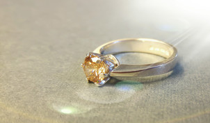 Silver ring in silver with champagne coloured cubic zirconia.