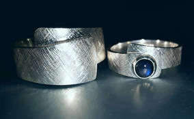 'Tea' wedding rings in silver with spectrolite. Desinged in 2018