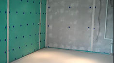 Two walls prior to damp proofing, covered with Delta membrane located in Peckham, London