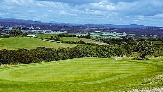 2nd Green and Brecon Beacons View at The Gower Golf Club.
