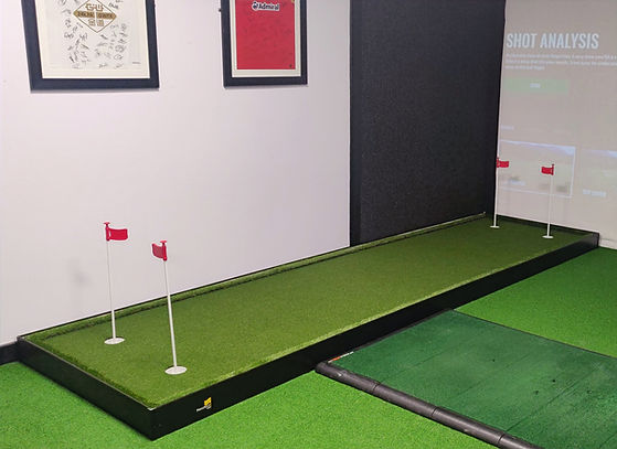 Adjustable putting green used for golf lessons at The Gower Golf Studio, Swansea.