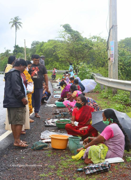 Fisherwomen sell their fishes next to Mithmumbari bridge area in the evening