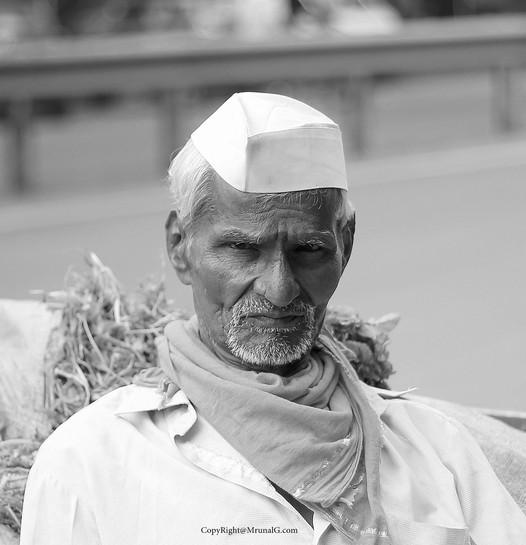 Farmer resting at Sus-Pashan road