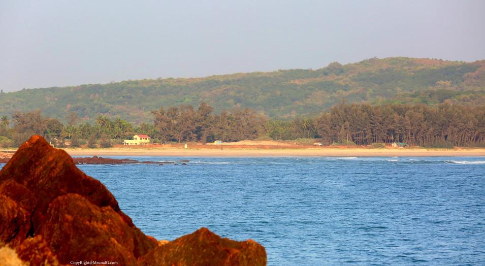 Mithmumbri beach view from hills behind Devgad wind mills
