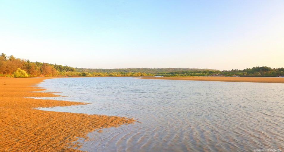 Low tide sand exposure at Taramumbri creek waters