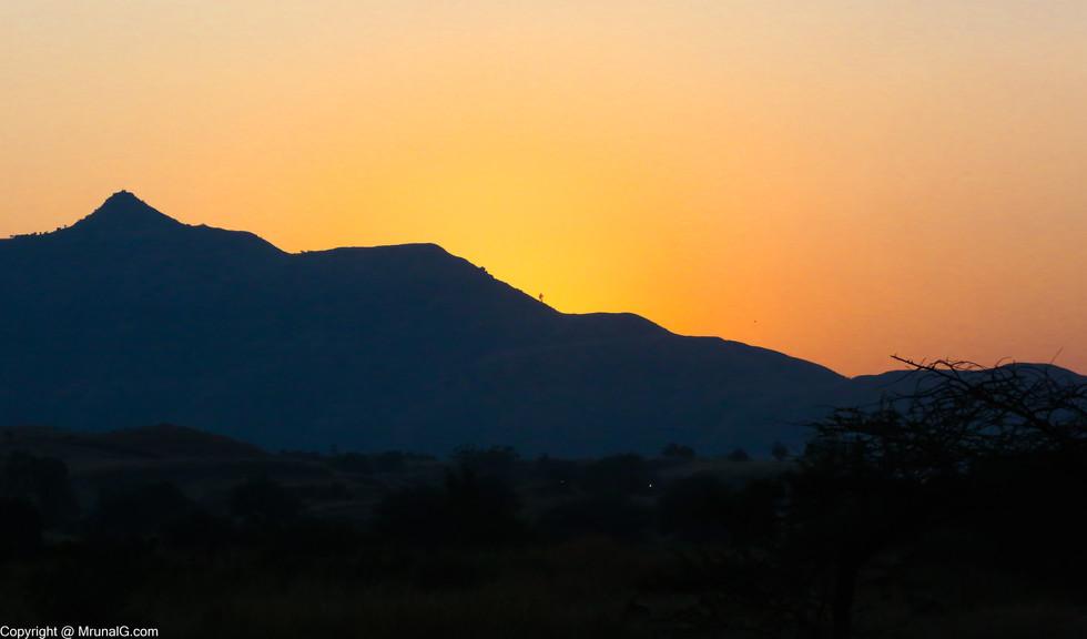 The sun sets on the Saswad hills