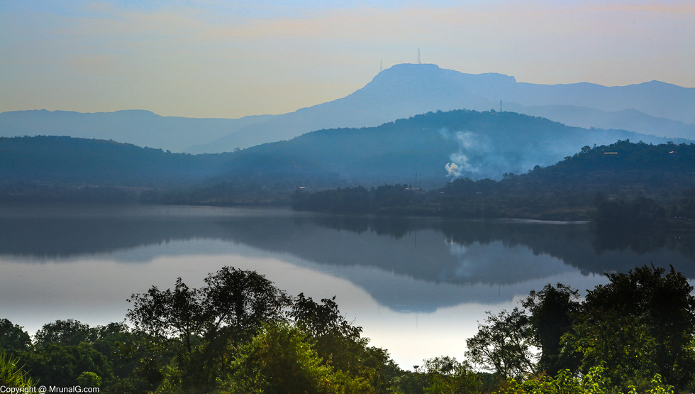 Sinhgad fort during early morning with the Khadkwasla dam backwaters