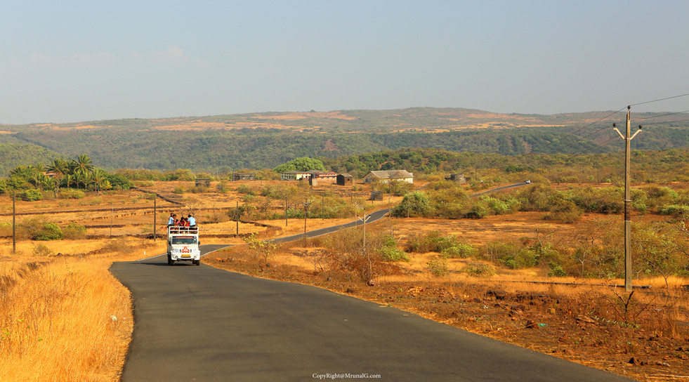 Road to Mithbav from Kunkeshwar near the hill view resort homes.