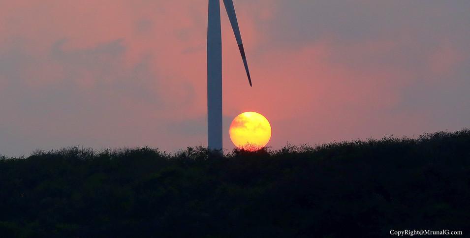 Sun sets at Devgad windmill from small beach next to Taramumbri beach