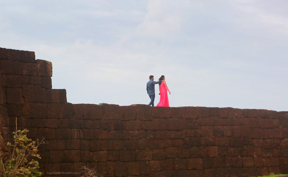 A couple takes a romantic walk on the fortified wall of the Devgad ford.