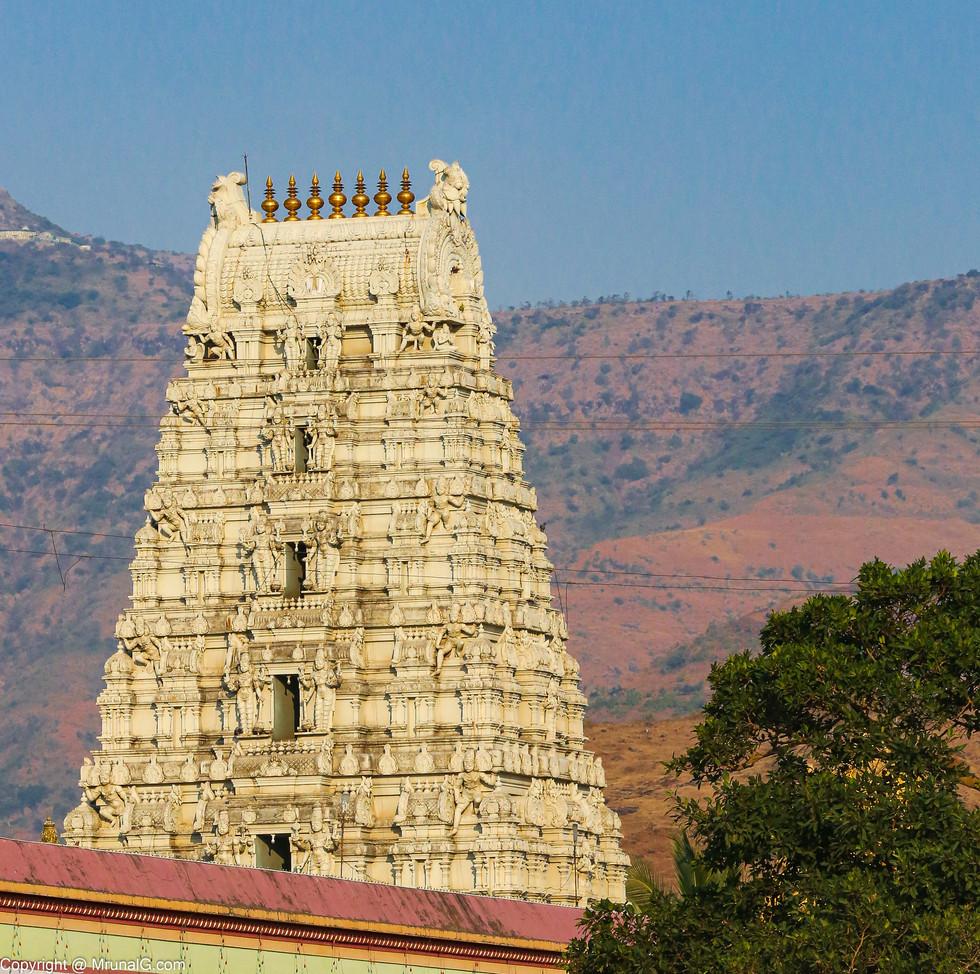 The Gopuram of the Prati Tirupati Balaji temple at Narayan pur Saswad area with the fort Purandhar in the backdrop