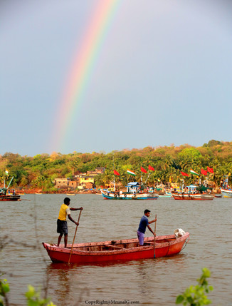 Raibow after the first rain of the season in the Devgad port area.