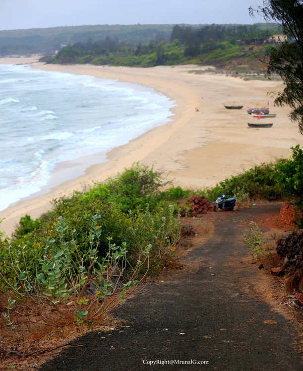 The end of Kunkeshwar beach and the road on the hill going downward towards the beach