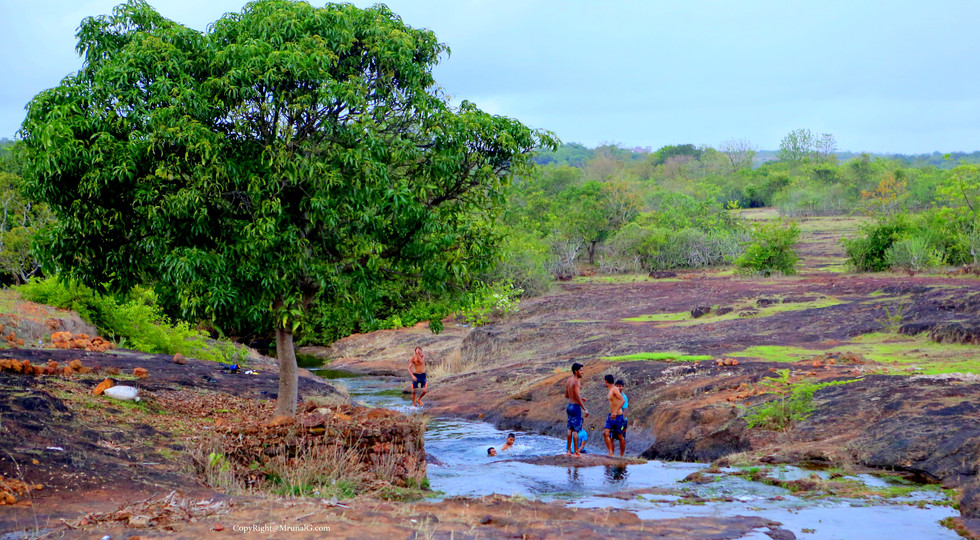 7.46 Vimleshwar temple surrounding water stream water sports by boys