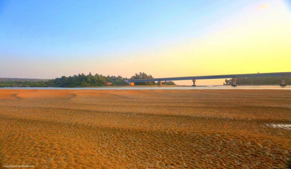 Sandy land exposed due to low tide next to Mithmumbri bridge area