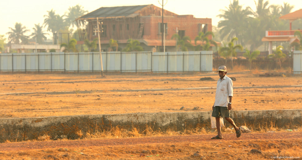 A villager walks from Bhatwadi area to Devgad