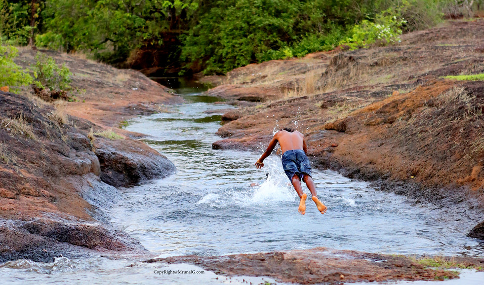 Water sport diving in the stream water near Vimleshwar temple