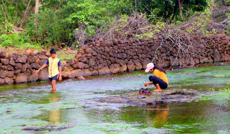 Two siblings doing mobile shooting in Devgad Katta area water stream