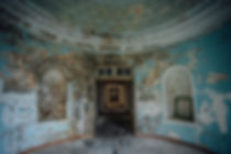 Old ruined abandoned mansion, interior of round hall.jpg