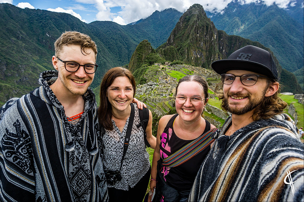 Four exhausted Belgians at Machu Picchu