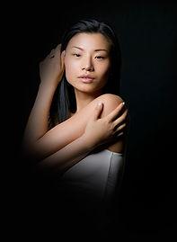 a woman striking a dramatic pose.