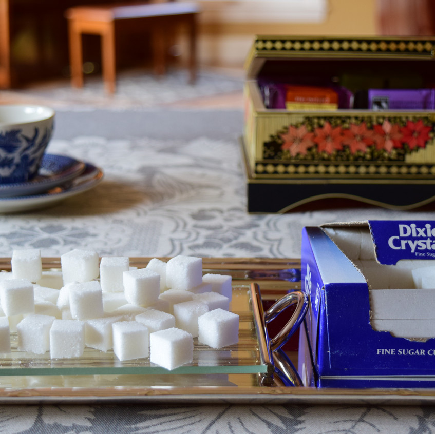 How are sugar cubes made | Sugar cube is granulated sugar that is moist with water and then compressed or molded into cubes. Sometimes are called 'gourmet sugars', when hand-molded into different sizes, shapes and colors. Typically contain over 95 percent sucrose.