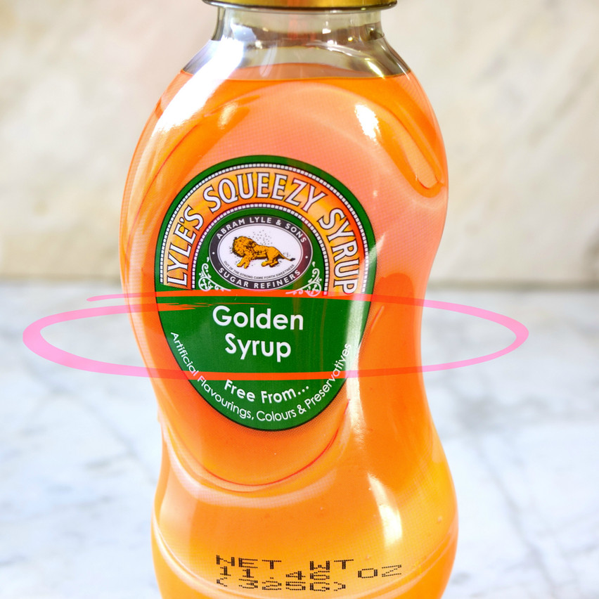 Golden Syrup is not Honey | Golden Syrup is aka invert sugar, cane syrup, invert syrup, inverted syrup, or simply 'invert'. It is a medium invert syrup that contains approx 80 percent sugars, being 30-40 sucrose, and 50 invert sugar (25 fructose, 25 glucose). It is often produced in a sugar refinery from 'Refiners Syrup', which are syrups left over in a refinery after sucrose crystallization. Refiners syrup is treated with acid or enzyme invertase at high temperatures to produce a clear, golden color syrup.