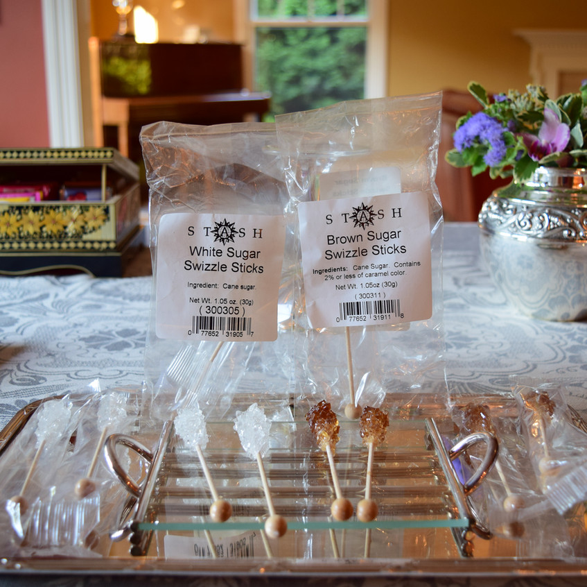 white sugar swizzle sticks are made at home or commercially from a hot saturated solution of granulated sugar. As the solution cools down, big sugar crystals form. They may contain additional ingredients such as food coloring. Typically contain over 95 percent sucrose.