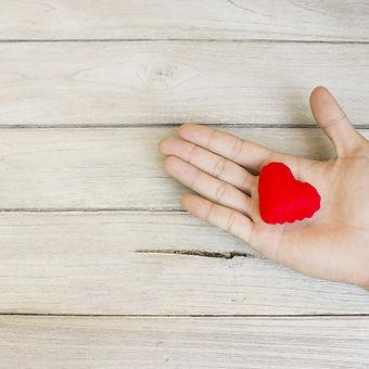 help,Heart in Hand on wood_edited.jpg