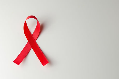 Red ribbon HIV, AIDS on gray background,