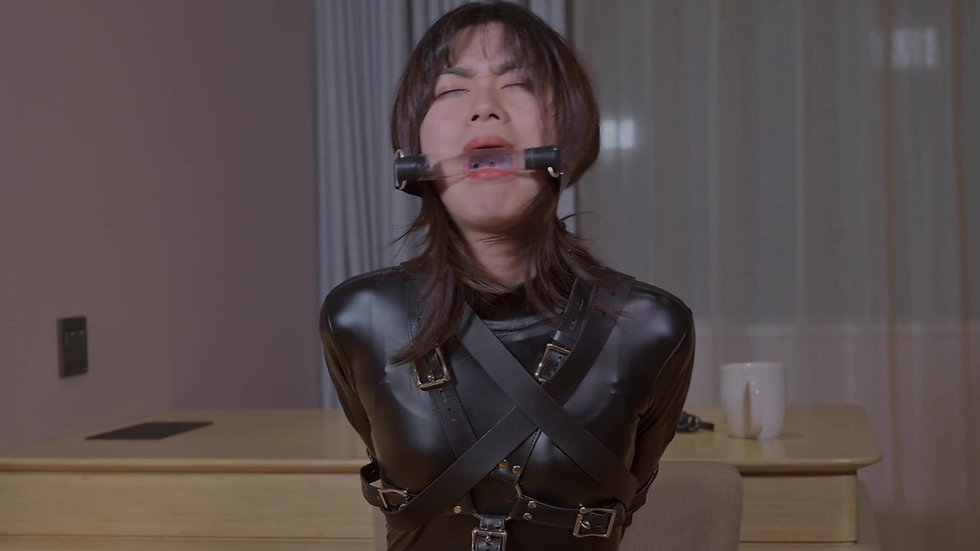 Catsuit girl is gag in a variety of ways