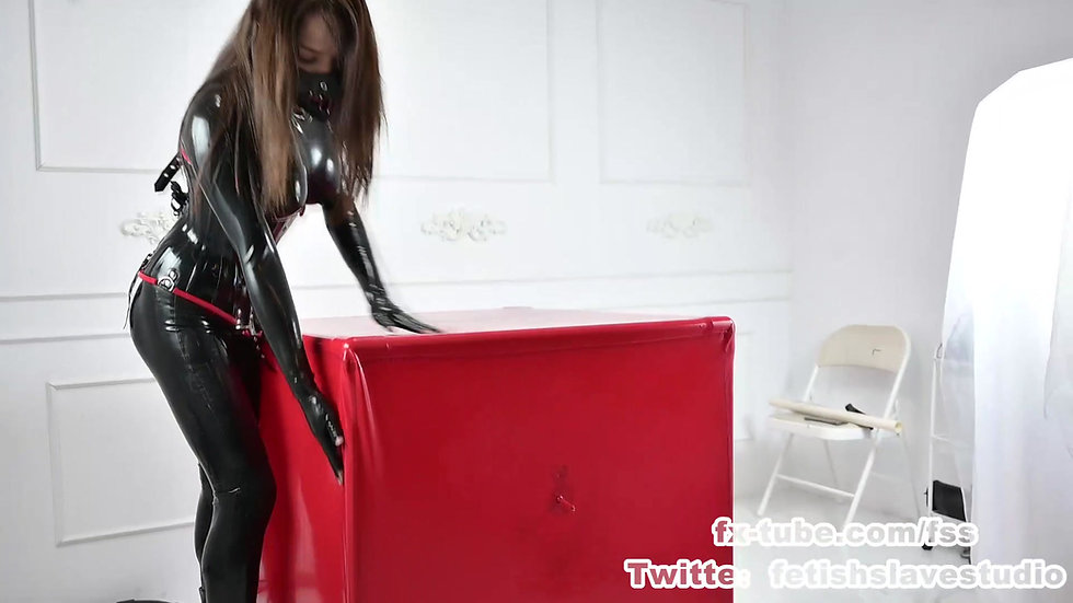 Latex Mistress femdom slave on vacuum box