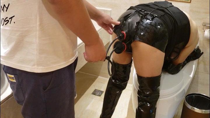 Leather slave girl double plugs and enema