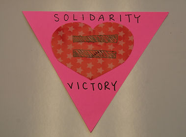 A pink triangle with heart and equality symbol