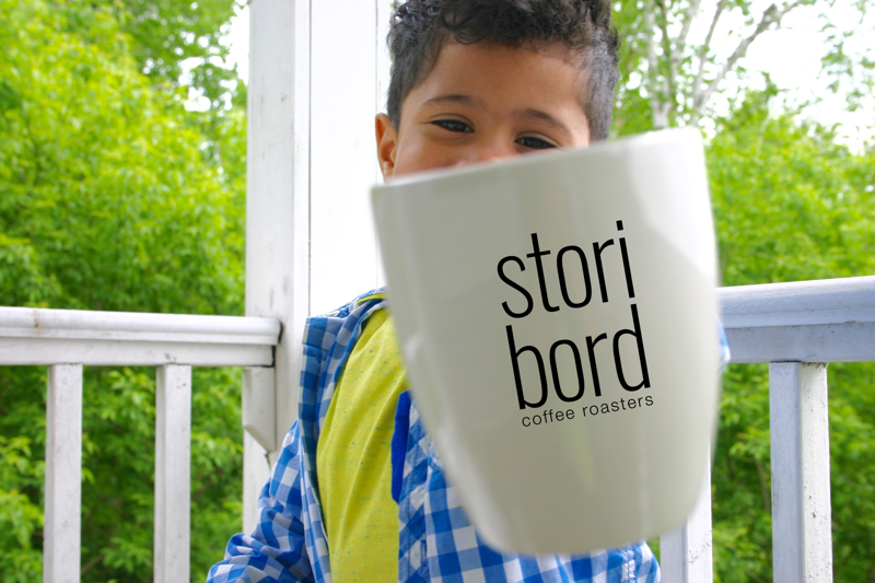 Child with coffee mug