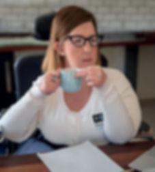 Natalie drinking coffee