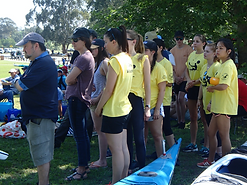 Nick Stepkovitch (left) with physio students at Windsor ready to demonstrate warm-up exercises to gathered paddlers at the pre-race briefing.