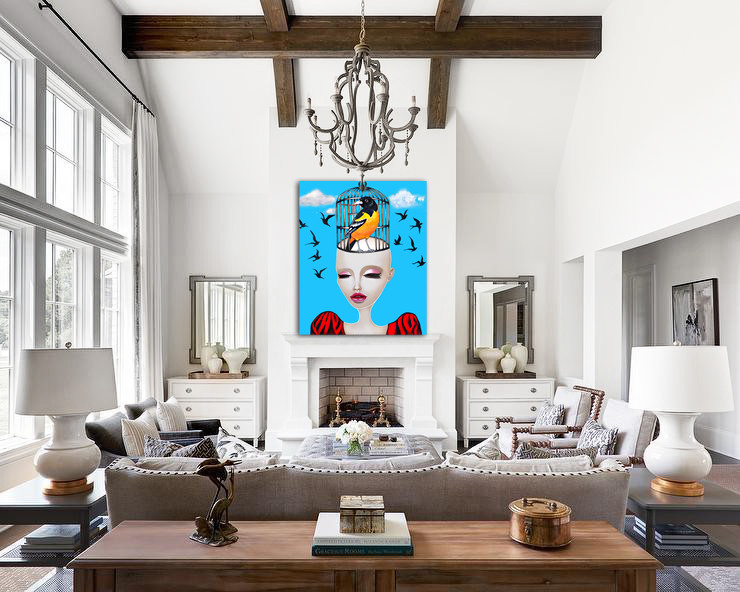 Oversized surrealism artwork in a beautifl white living room