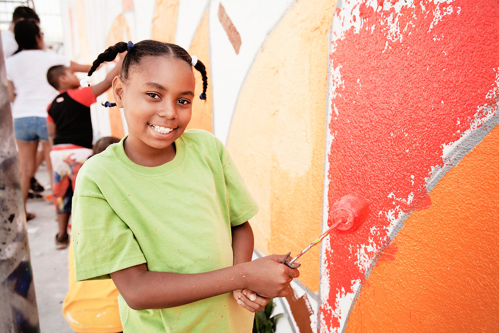 Painting wall, girl, happy, smile, creativity, artists, london creche mobile creche