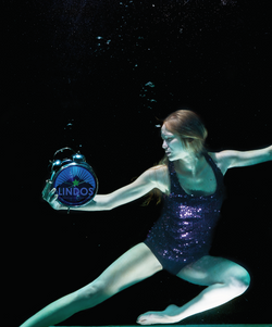 Lindos Woman in Underwater Holding Round