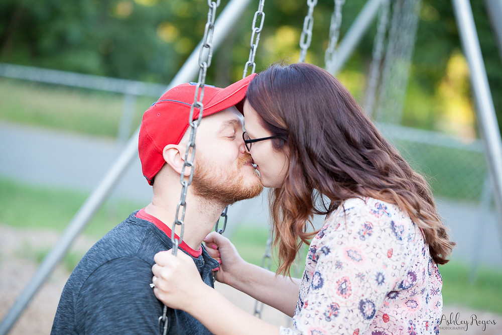 Couple kissing on a swing