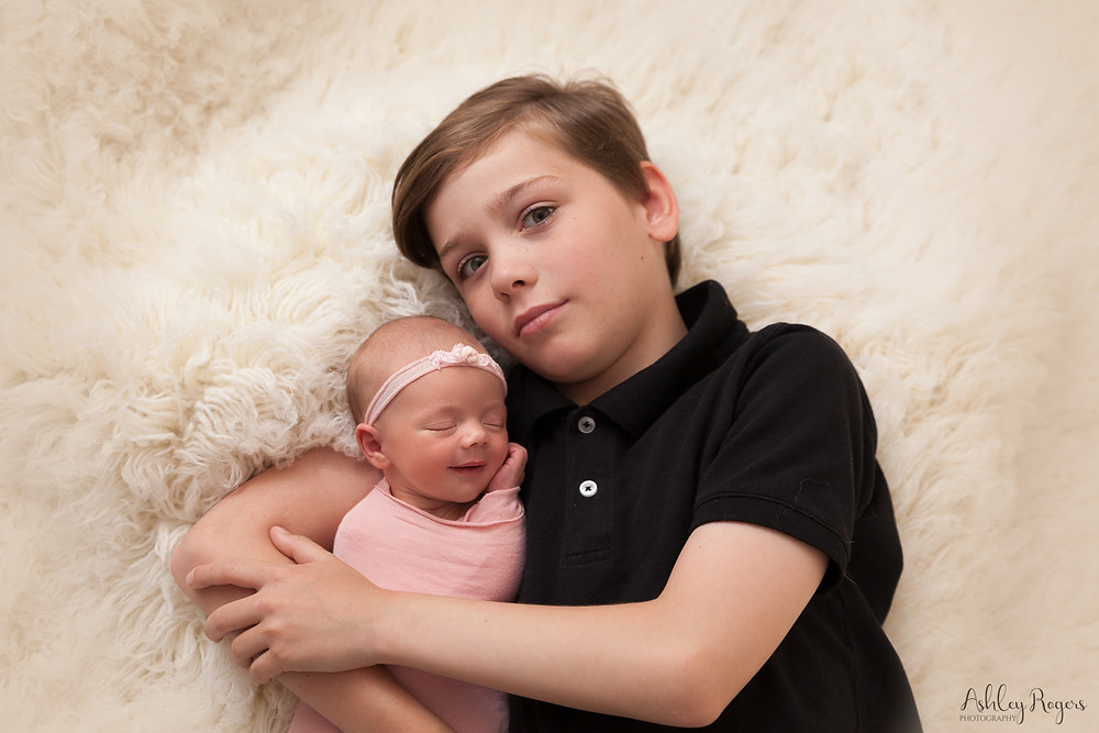 brother with newborn baby sister