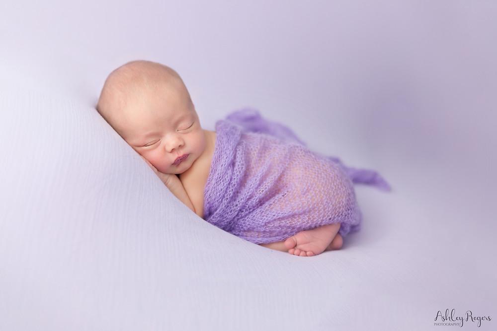 newborn girl on purple