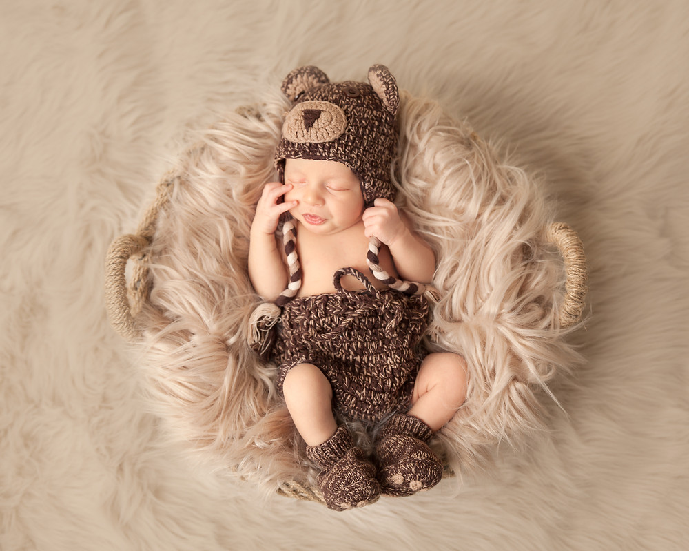 newborn in bear hat