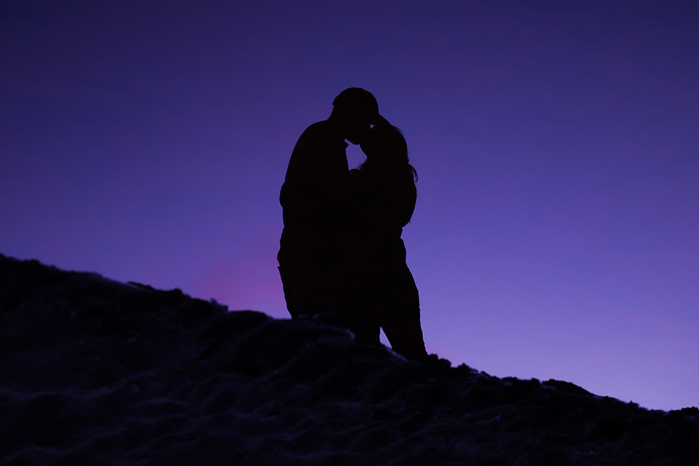 silhouette photo of couple kissing