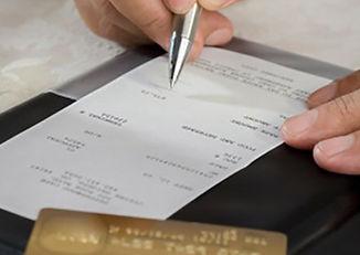 signing restaurant receipt (1 of 1).jpg