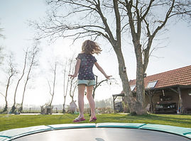 Gril Jumping on Trampoline